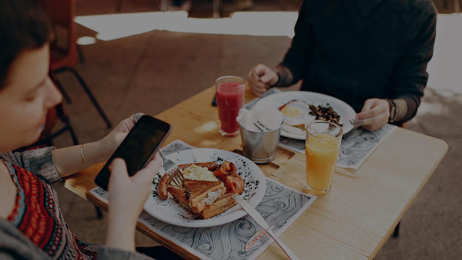 Breakfast diner looking at phone