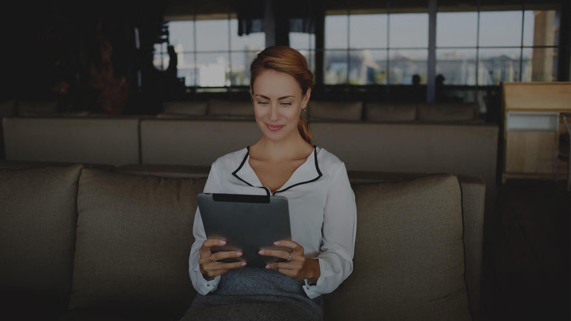 Landing Page Image - Woman iPad Compressed.jpg
