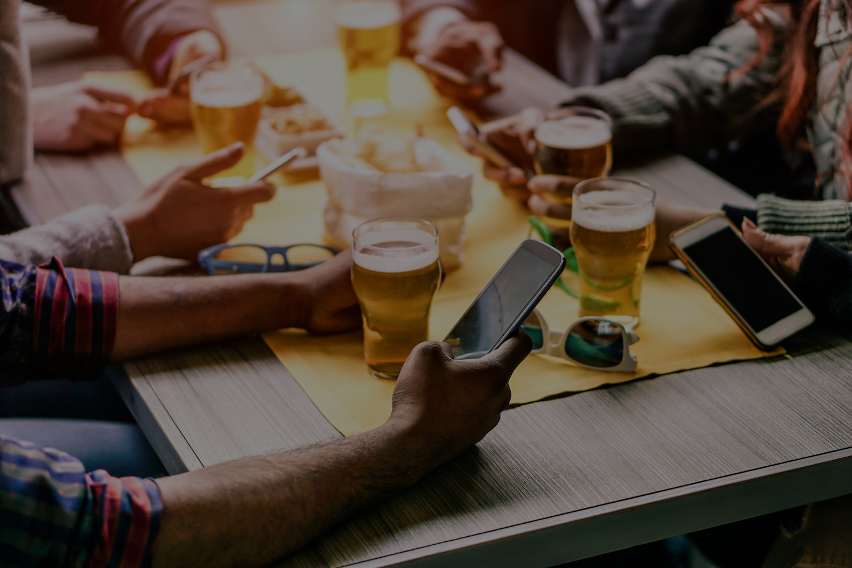 Students at pub on phones